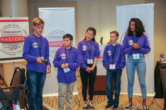 Salem student John Madland, left, competes in a challenge as part of the national Broadcom Masters STEM finals in Washington, D.C. in Oct. 2018.