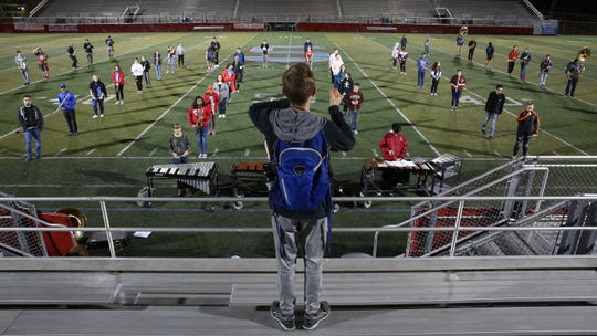 South Salem High School's marching band practices on the field on Monday, Oct. 15 in South Salem.