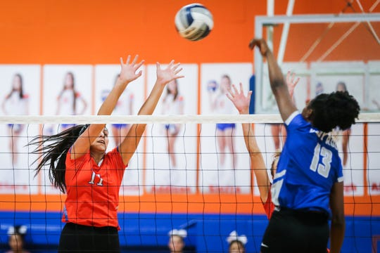 Central's Kirsten Gomez jumps to block Weatherford Tuesday, Oct. 23, 2018, at Babe Didrikson Gym.