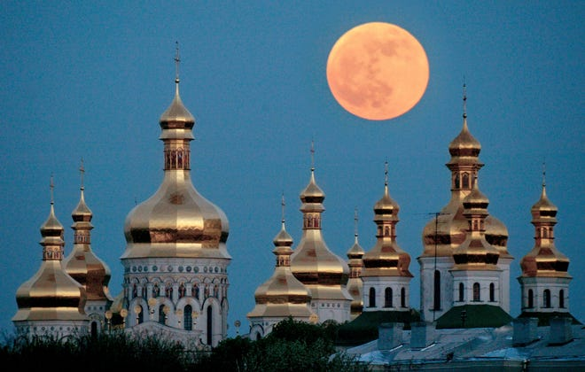 FILE - In this May 4, 2004 file photo, a full moon rises above the golden domes of the Orthodox Monastery of the Caves in Kiev, Ukraine. Tensions over the imminent formation of a Ukrainian Orthodox church independent of Moscow are raising fears that nationalists will try to seize Russian church properties.