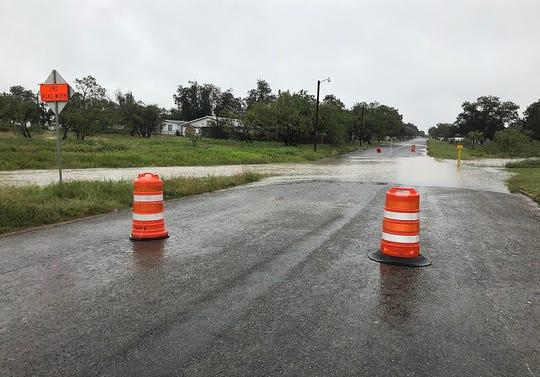Orange cones block the low water crossing Wednesday, Oct. 24, 2018 on Koberlin Street near N Bell Street.