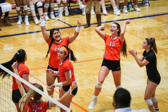 Central players celebrate a set against Weatherford Tuesday, Oct. 23, 2018, at Babe Didrikson Gym.