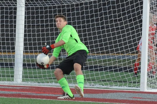 JMB keeper Gabe Dunn looks to throw down field during the Bayside Championship boys soccer game Tuesday, Oct. 23, 2018. Bennett won 1-0 in overtime.
