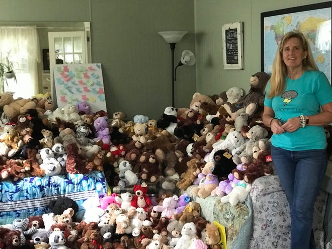 Cori Salchert with a portion of the bears being donated following the death of her adoptive son Samuel. Around 500 bears have been sent to the Salcherts so far in T Bear's memory.