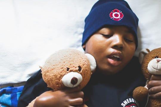 Samuel Laevell ' T Bear' Salchert with his own teddy bear.