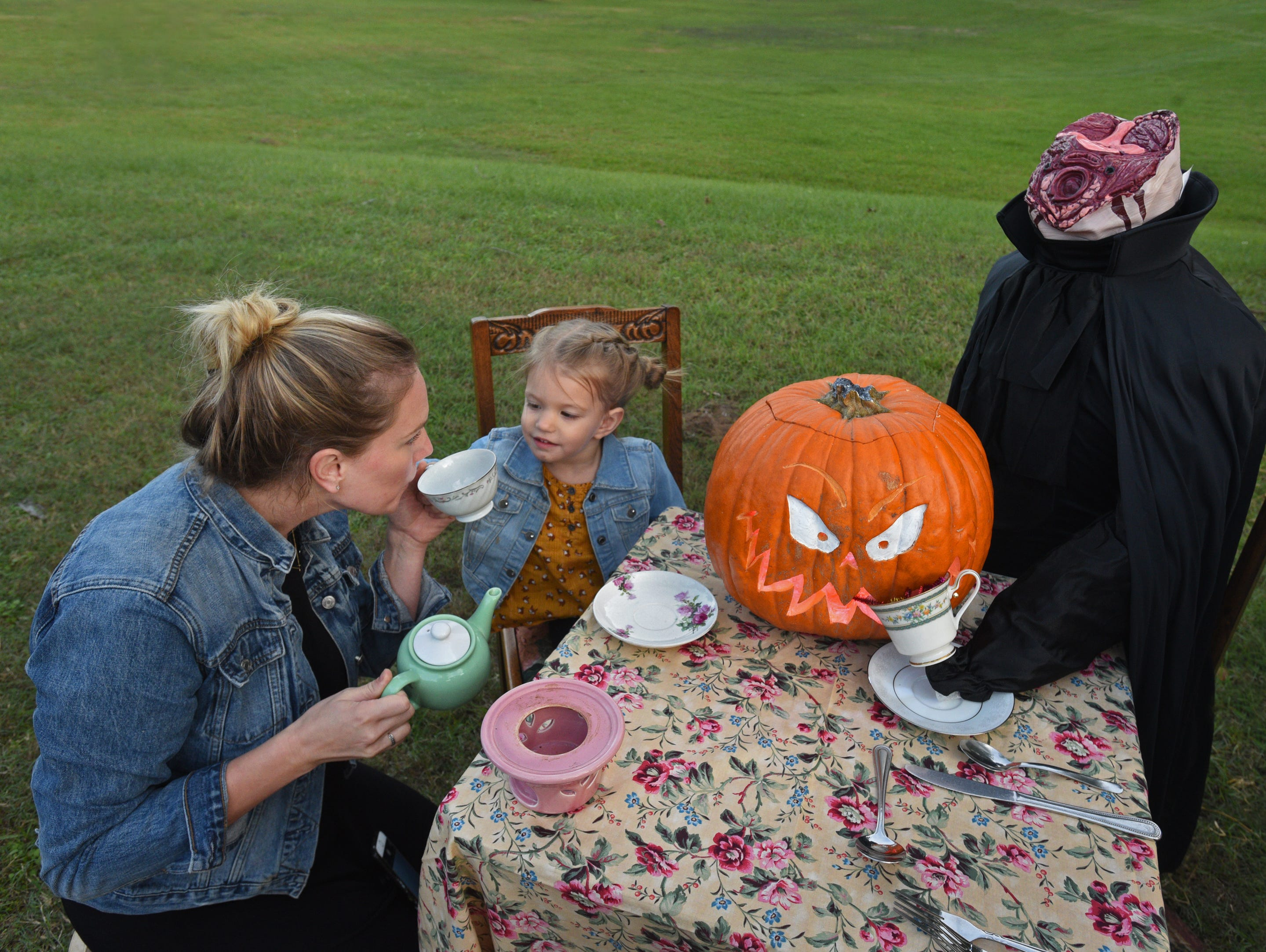 Kristin and Hadley Howell have a tea party at the 26th Annual Pumpkin Shine on Line held Tuesday at Betty Virginia Park.