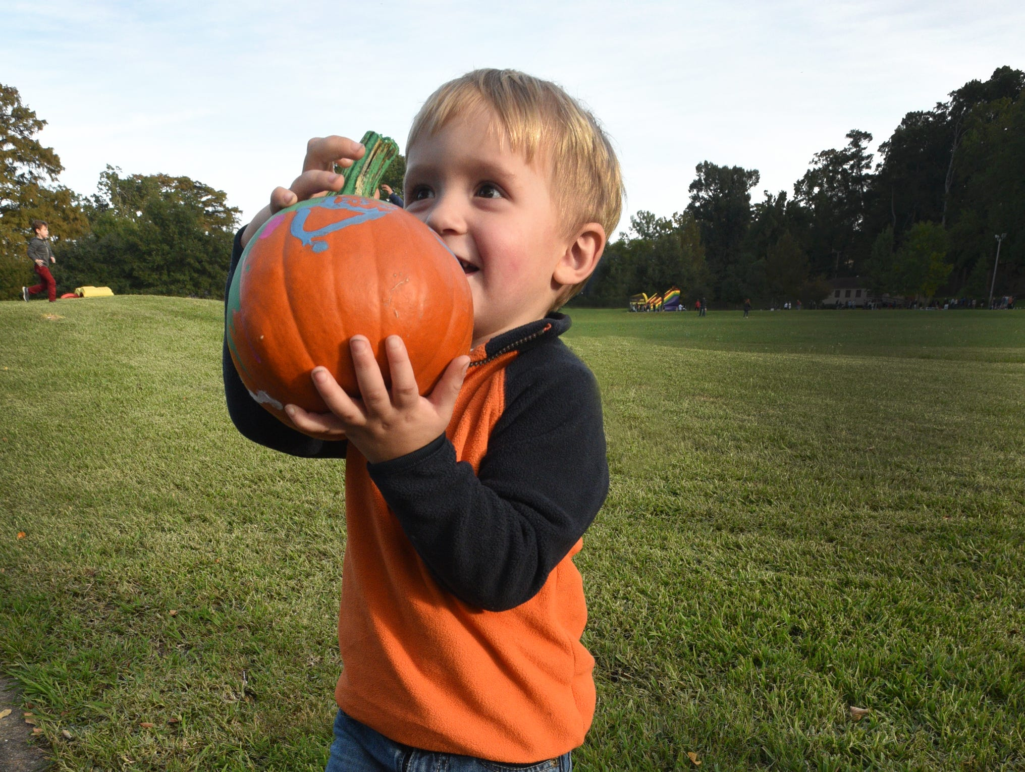 Easton Harvey wants a super hero pumpkin at the 26th Annual Pumpkin Shine on Line held Tuesday at Betty Virginia Park.