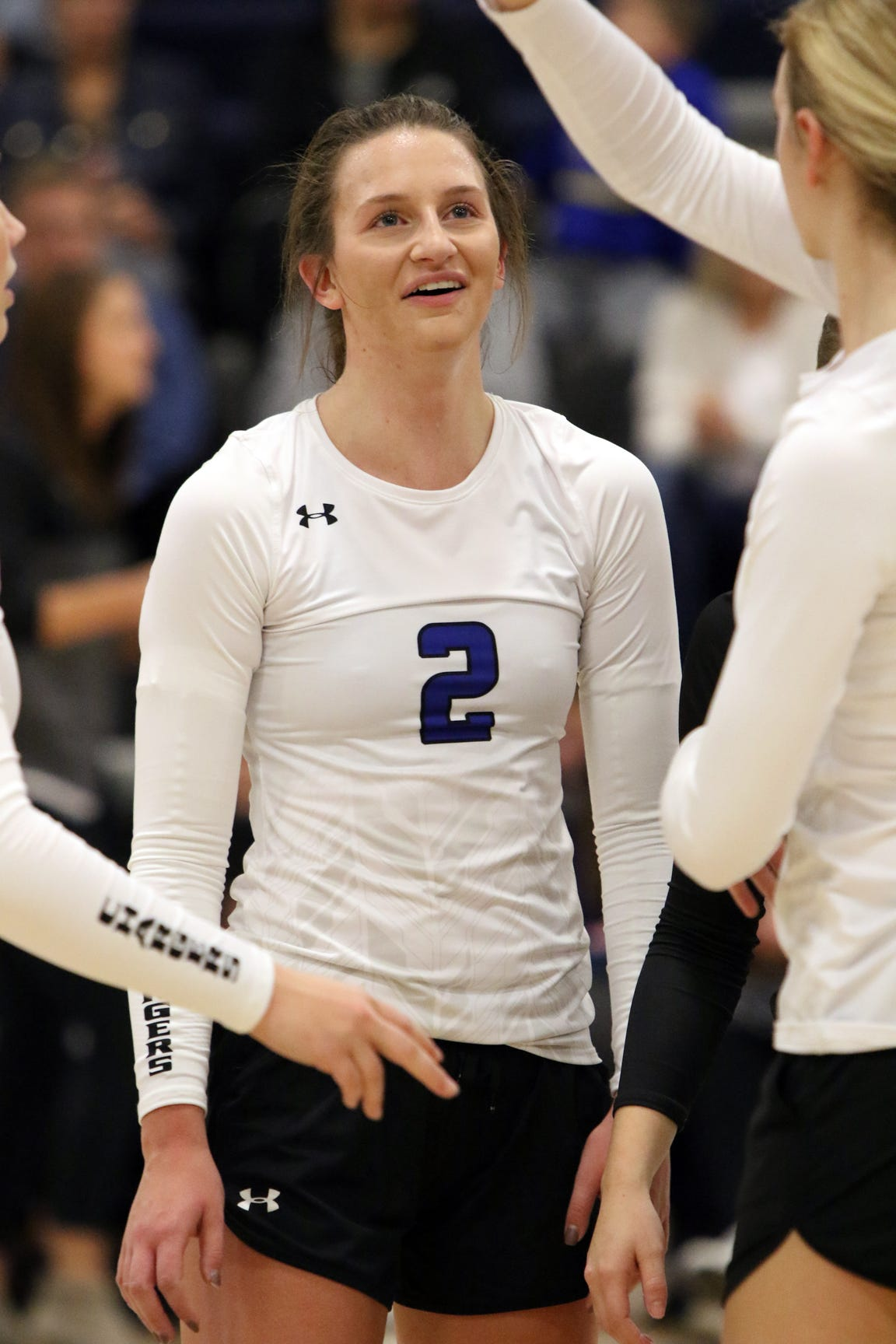 Kylee Van Egdom of Sioux Falls Christian celebrates another point with her teammates during Monday's match against Lennox in Sioux Falls.