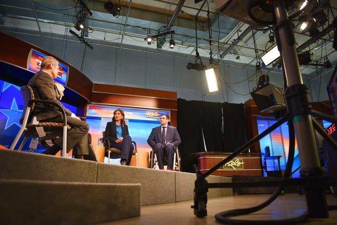 Kristi Noem and Billie Sutton sit down with Don Jorgensen and Sammi Bjelland for the gubernatorial debate Tuesday, Oct. 23, at KELO TV in Sioux Falls.