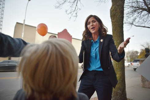 Kristi Noem greets a young supporter outside of KELO TV before the gubernatorial debate with Billie Sutton Tuesday, Oct. 23, at KELO TV in Sioux Falls.