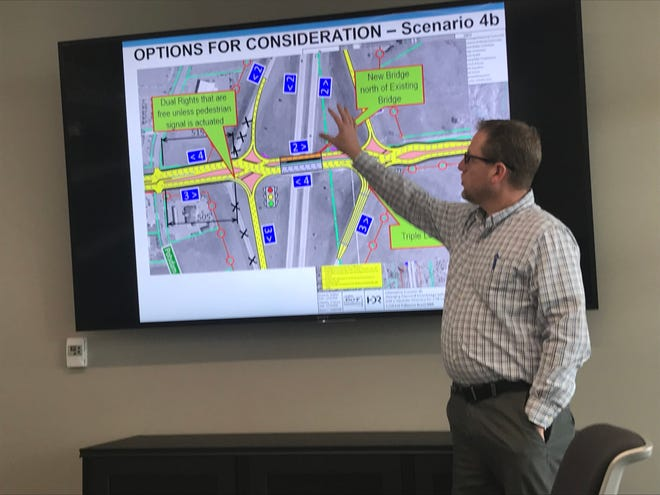 Jason Kjenstad, vice president and area manager of engineering firm HDR, discusses how diverging diamonds work Wednesday in a meeting room at City Center.
