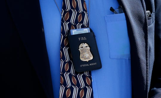 The badge of an FBI agent in Springfield on Wednesday, Oct. 24, 2018.