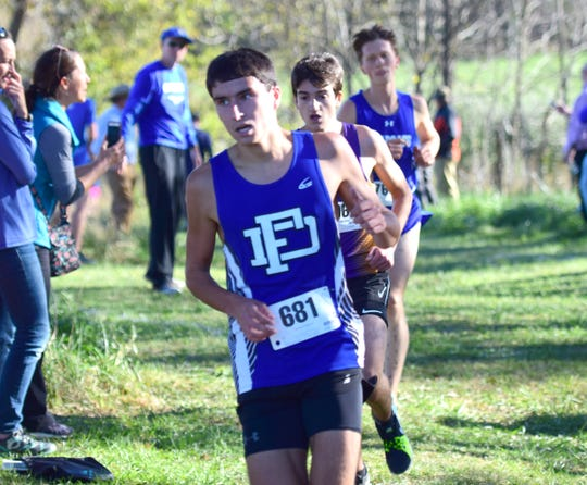 Fort Defiance's Ben Harlow stays ahead of Waynesboro's Stuart Vailes during the boys varsity race at the Valley District Cross Country Championships on Tuesday, Oct. 23, 2018, at Mill Place Park in Verona, Va.