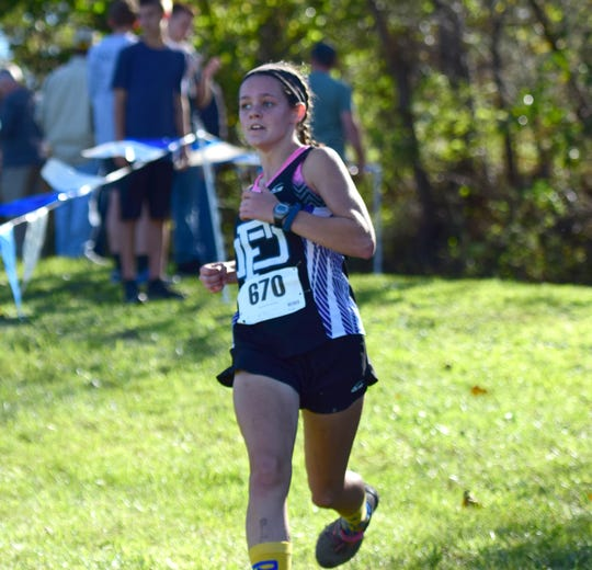 Fort Defiance's Delaney Stogdale looks toward the finish line of the girls varsity race at the Valley District Cross Country Championships on Tuesday, Oct. 23, 2018, at Mill Place Park in Verona, Va.