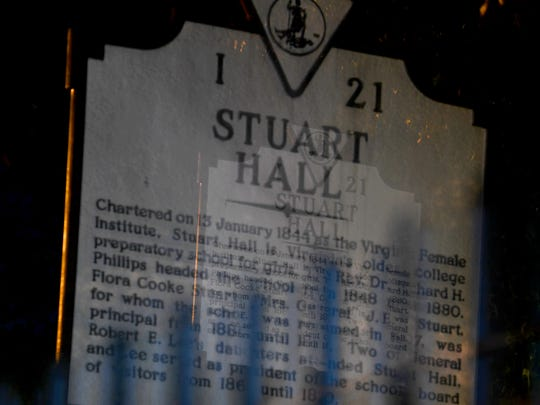 A telephoto lens zoomed during a timed exposure creates an eerie view of a Virginia historical marker about Stuart Hall School on West Frederick Street in Staunton on Tuesday, Oct. 23, 2018.