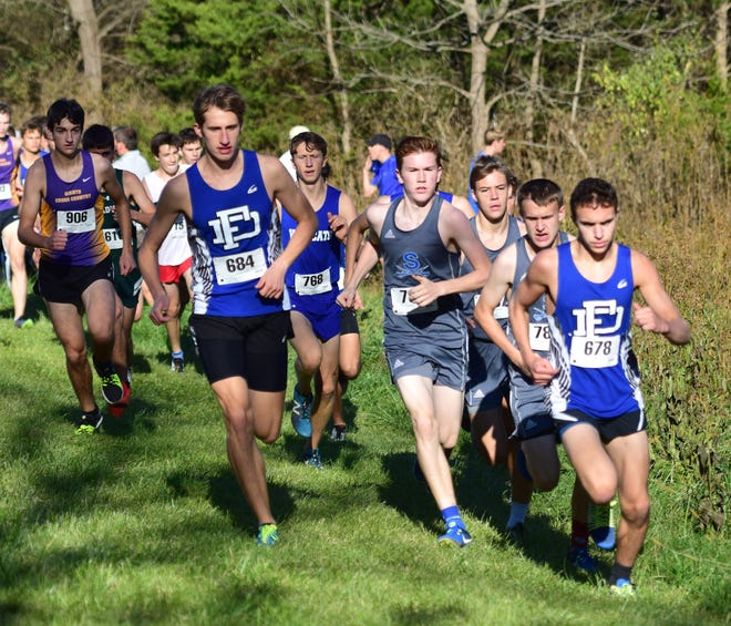 Fort Defiance's Jacob Jones, left, and Ramsey Corbin, right, lead the pack through the opening moments of the boys varsity race at the Valley District Cross Country Championships on Tuesday, Oct. 23, 2018, at Mill Place Park in Verona, Va.