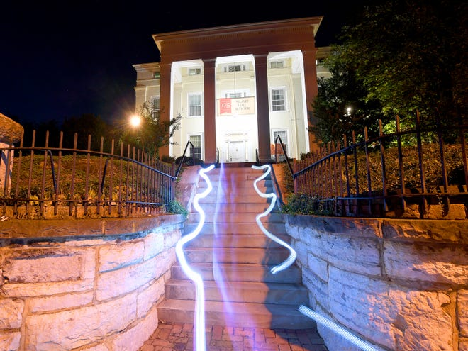 Streaks of light created through a timed camera exposure and a technique called light painting line the steps leading up to the front of Stuart Hall School in Staunton on Tuesday, Oct. 23, 2018.