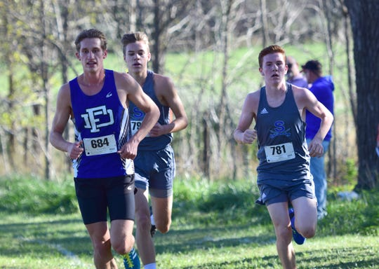 Fort Defiance's Jacob Jones, left runs with Spotswood's Connor Amberg during the boys varsity race at the Valley District Cross Country Championships on Tuesday, Oct. 23, 2018, at Mill Place Park in Verona, Va.