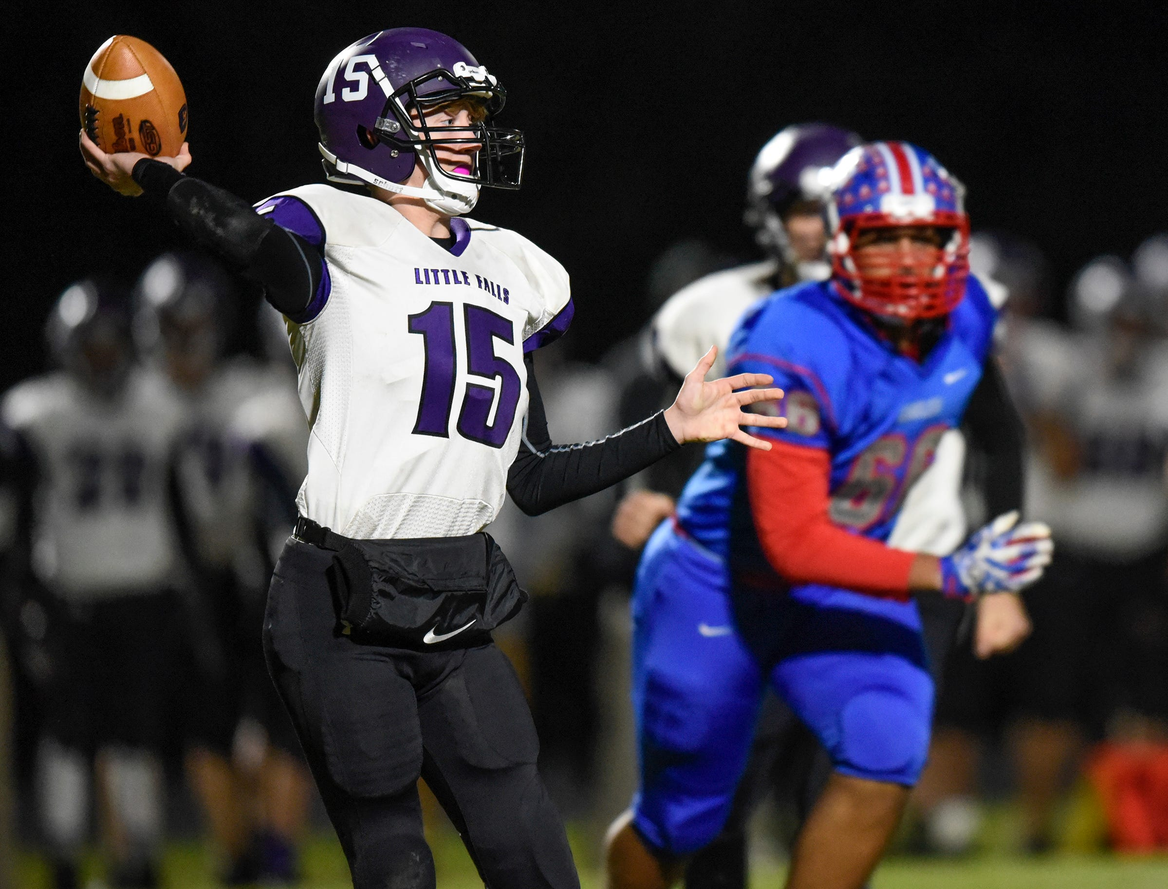 Little Falls quarterback Austin Udy drops back to pass during the Tuesday, Oct. 23, game against Apollo in St. Cloud.