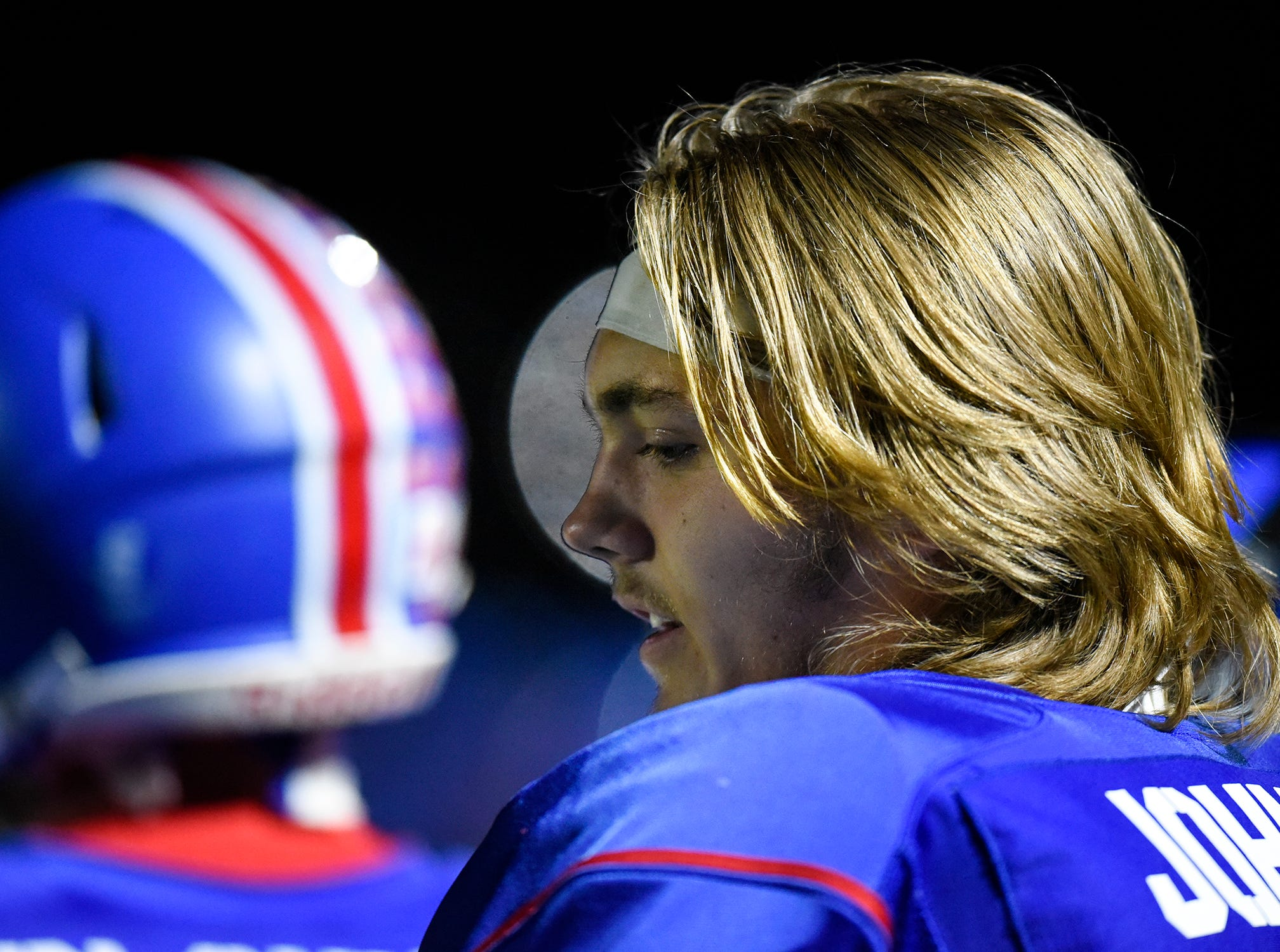 Apollo's Logan Johnson talks with other players on the sidelines during the Tuesday, Oct. 23, game against Little Falls in St. Cloud.