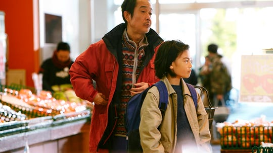 """Shoplifters,"" directed by Hirokazu Kore-eda, centers on a father and son who shoplift to feed their family."