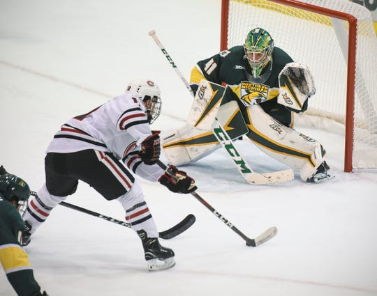 St. Cloud State's Jack Ahcan takes a shot on goal during the Saturday, Oct. 20, game against Northern Michigan at the Herb Brooks National Hockey Center in St. Cloud.