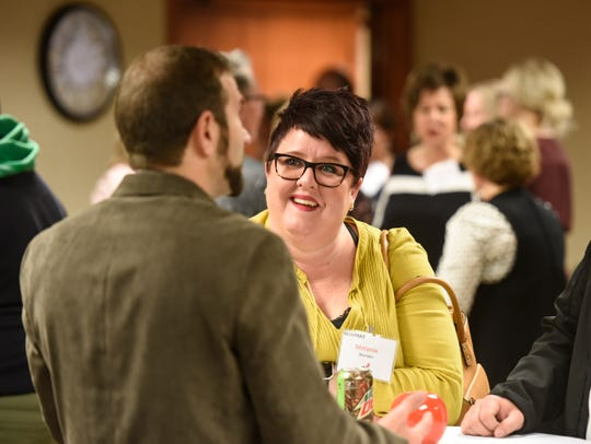 Runner-up Melanie Wander talks with attendees Tuesday, Oct. 23, during the ChangeMakers awards ceremony at the St. Cloud Federal Credit Union.