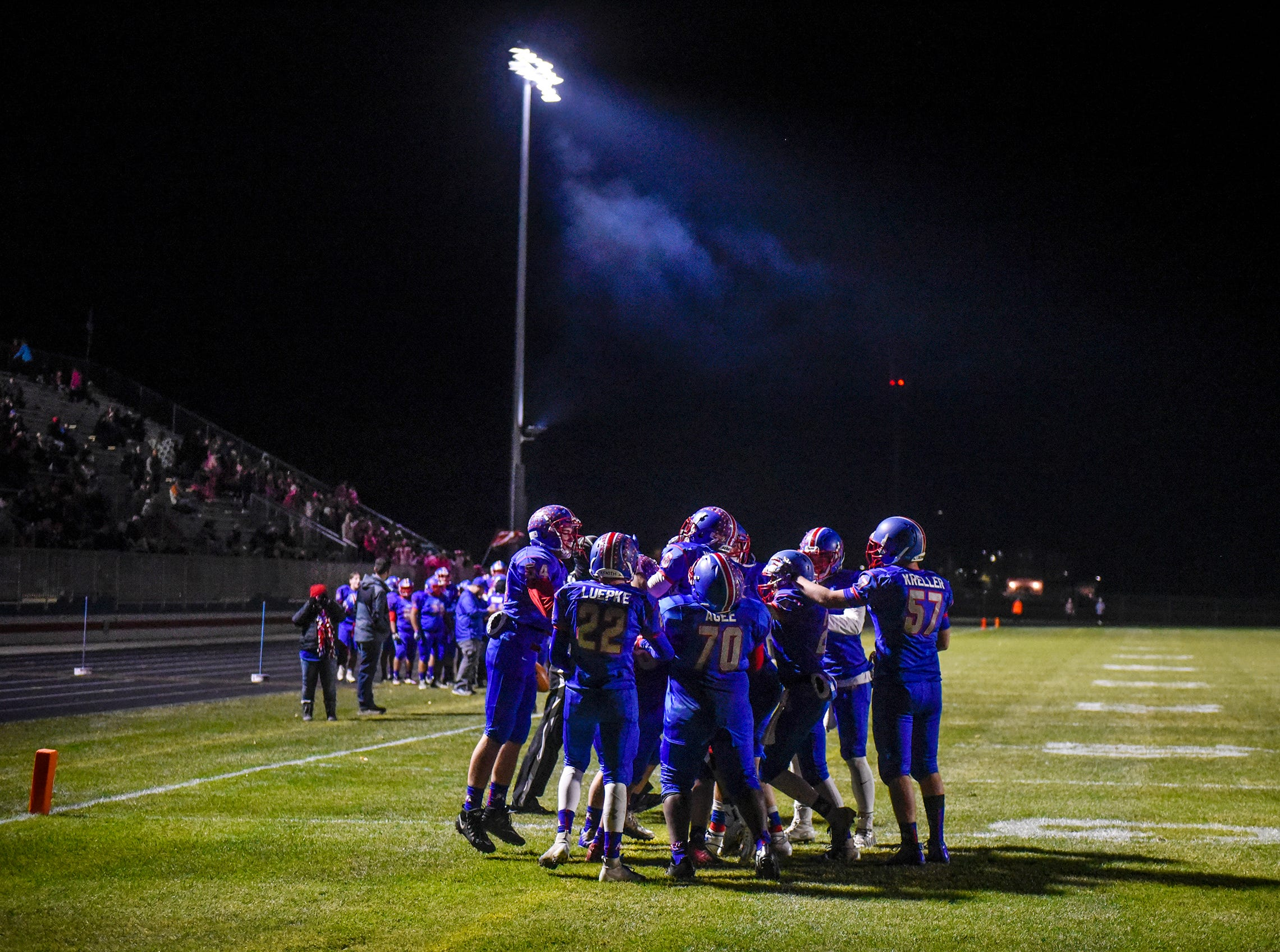 Apollo players gather to celebrate a touchdown during the first half of the Tuesday, Oct. 23, game against Little Falls in St. Cloud.