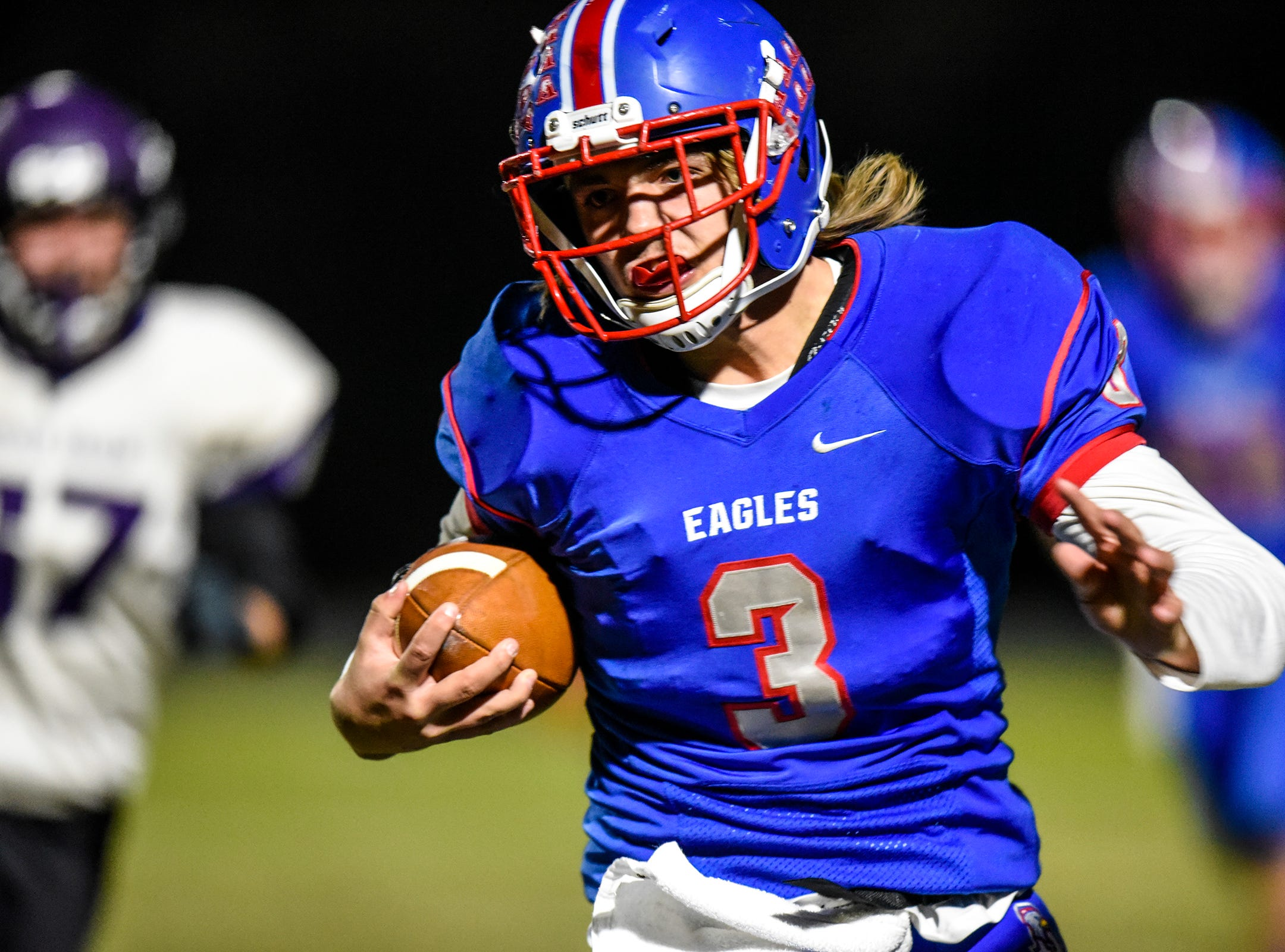 Apollo's Logan Johnson carries the ball during the Tuesday, Oct. 23, game against Little Falls in St. Cloud.