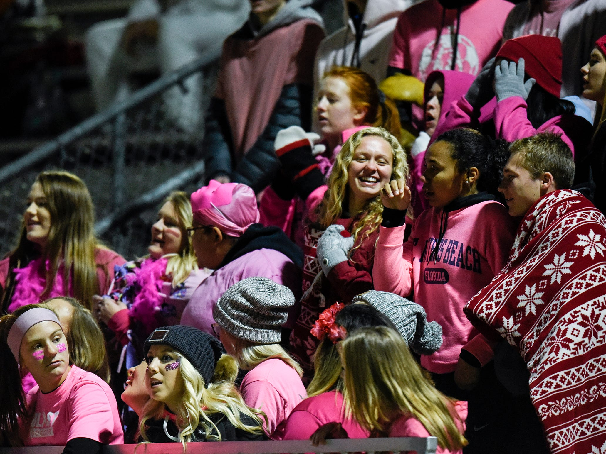 Apollo fans cheer for their team before the start of the Tuesday, Oct. 23, game against Little Falls in St. Cloud.