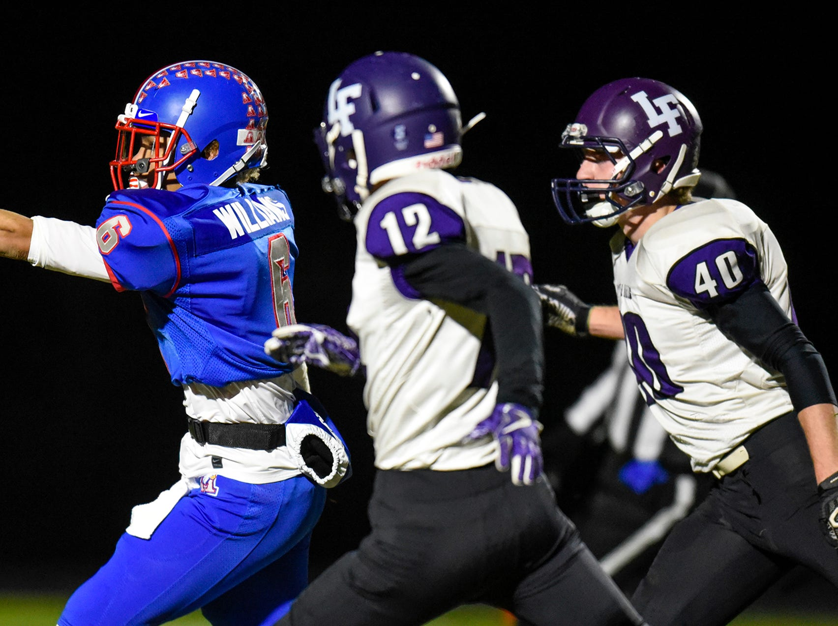 Apollo's Jalyn Williams stretches the ball across the goal line for a touchdown during the Tuesday, Oct. 23, game against Little Falls in St. Cloud.