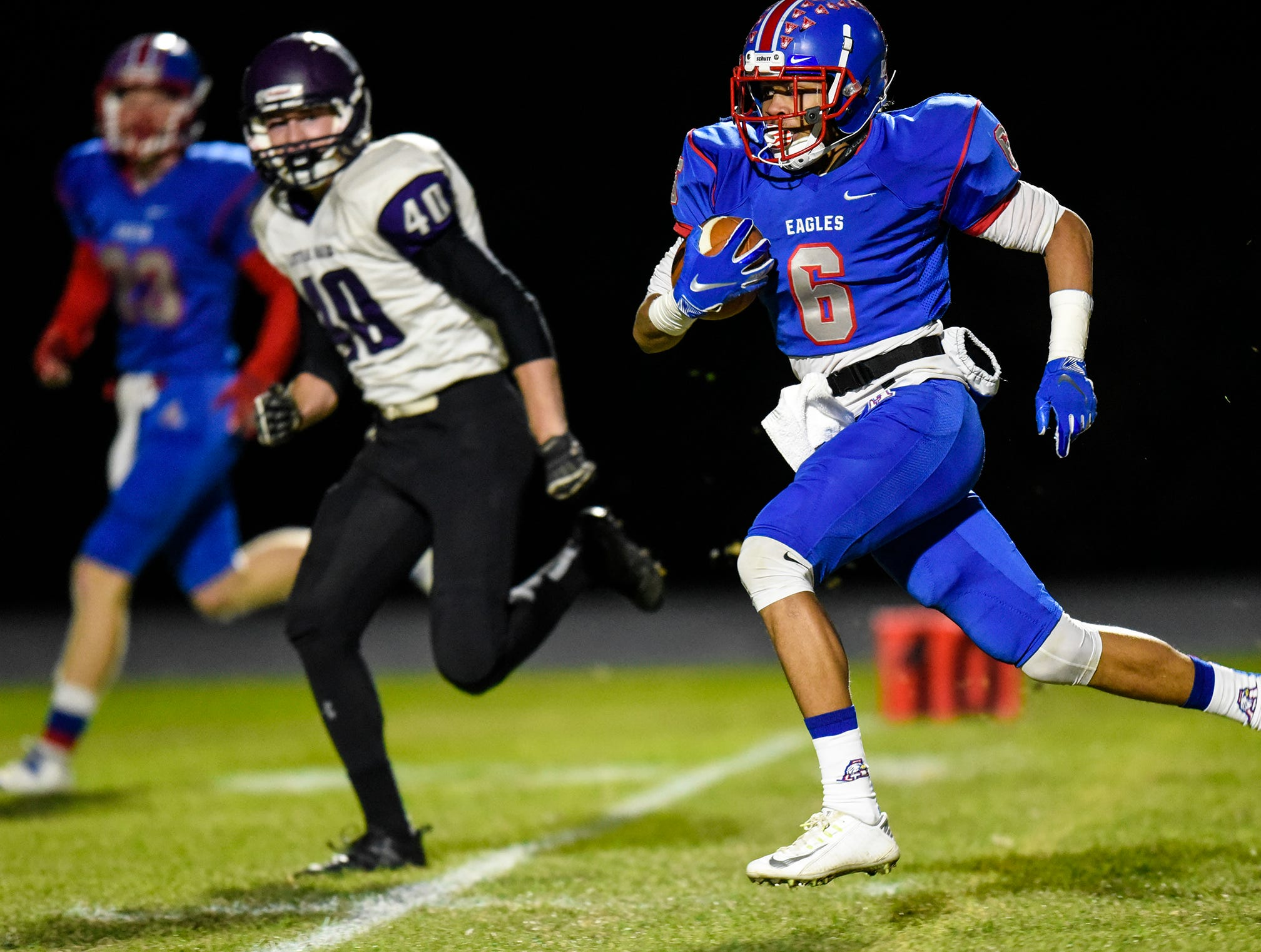 Jalyn Williams rushes for Apollo during the Tuesday, Oct. 23, game against Little Falls in St. Cloud.