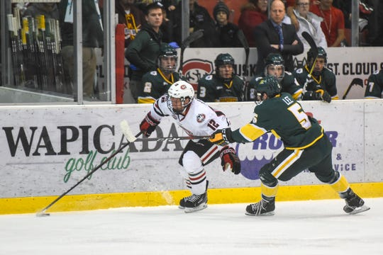 Jack Ahcan moves the puck for St. Cloud State during the Saturday, Oct. 20, game against Northern Michigan at the Herb Brooks National Hockey Center in St. Cloud.