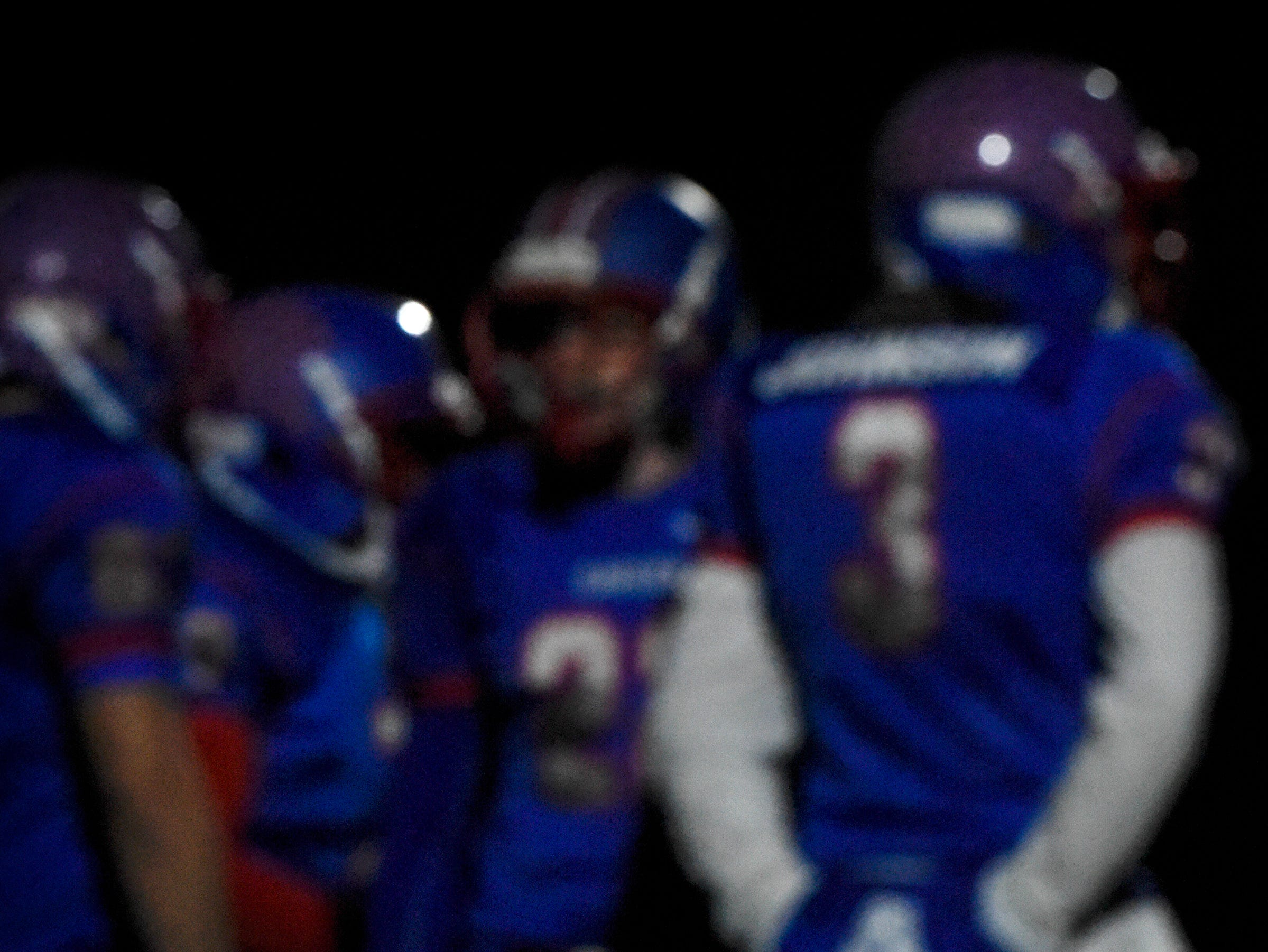 A full moon rises behind Apollo players before the start of the Tuesday, Oct. 23, game against Little Falls in St. Cloud.