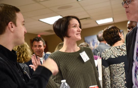 Runner-up Jody Barth talks with attendees Tuesday, Oct. 23, during the ChangeMakers awards ceremony at the St. Cloud Federal Credit Union.