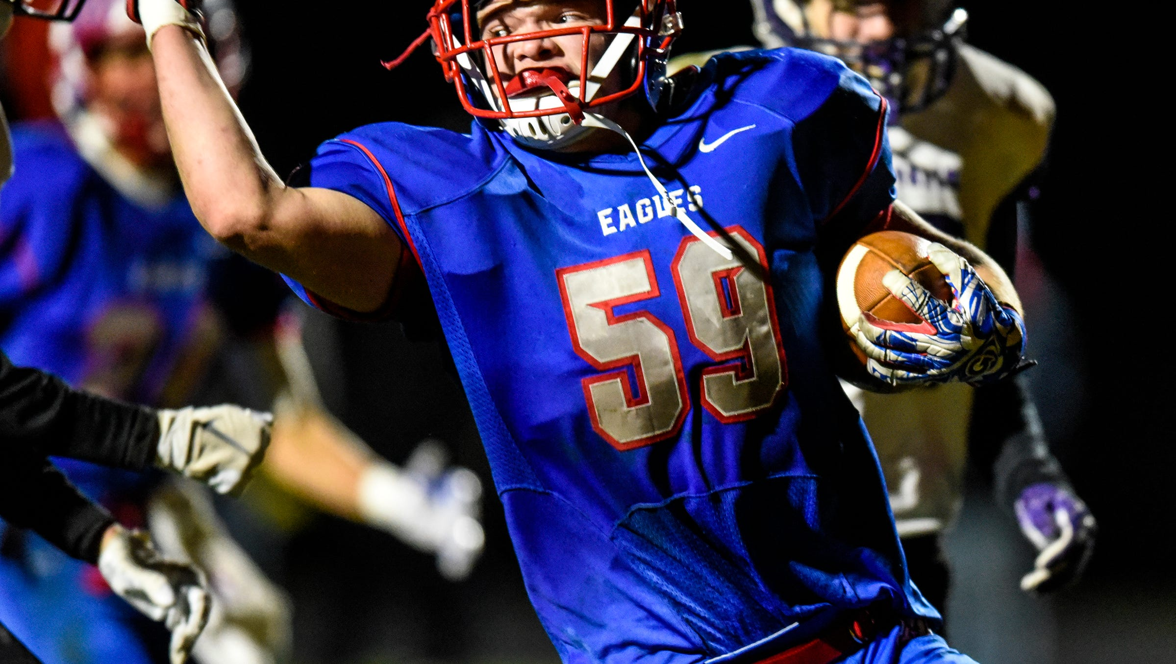 Apollo's Isaac Erickson-Thoemke celebrates as he crosses the goal line to score a touchdown during the Tuesday, Oct. 23, game against Little Falls in St. Cloud.