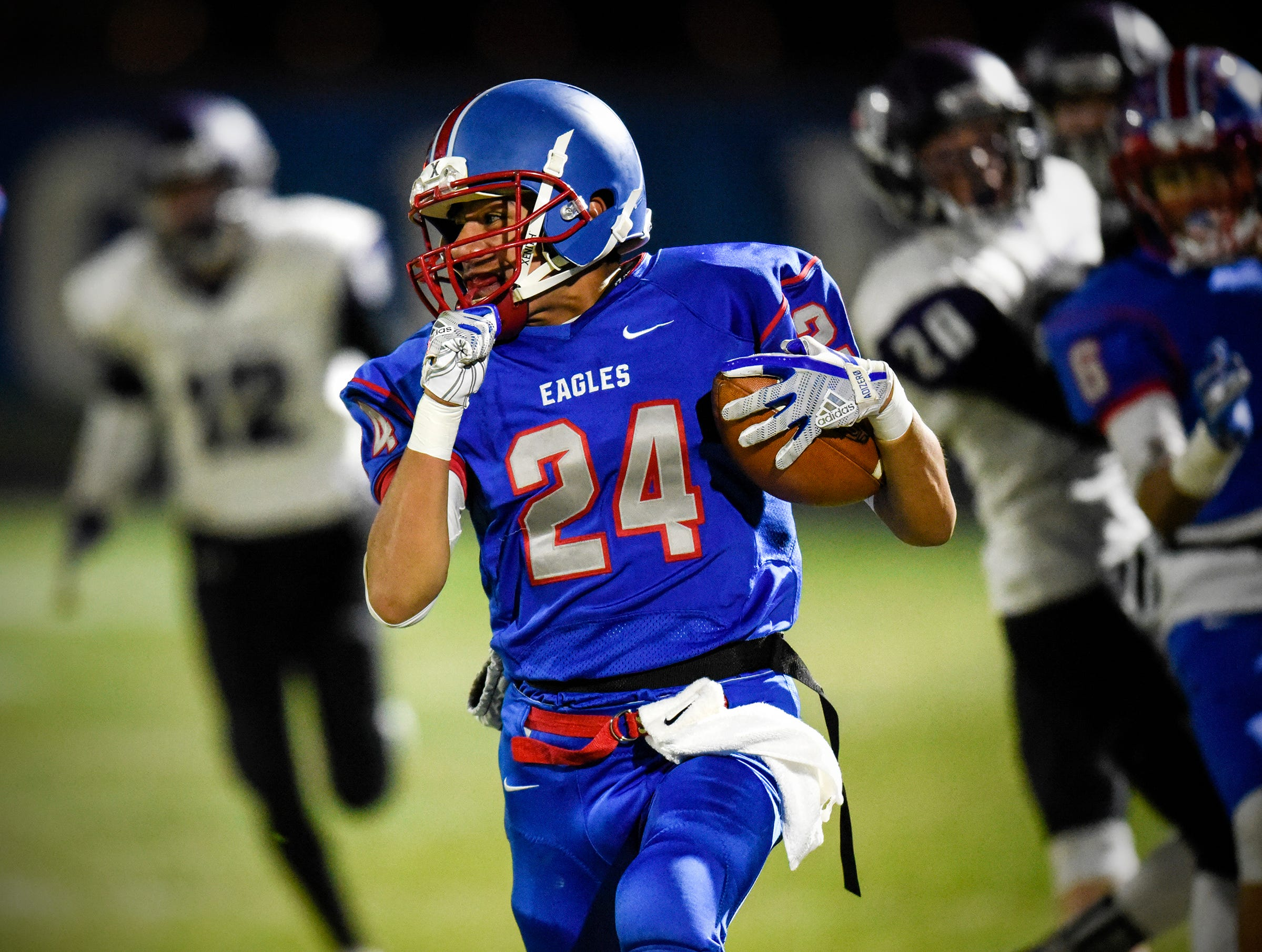 Apollo's Likas Theisen rushes with the football during the Tuesday, Oct. 23, game against Little Falls in St. Cloud.