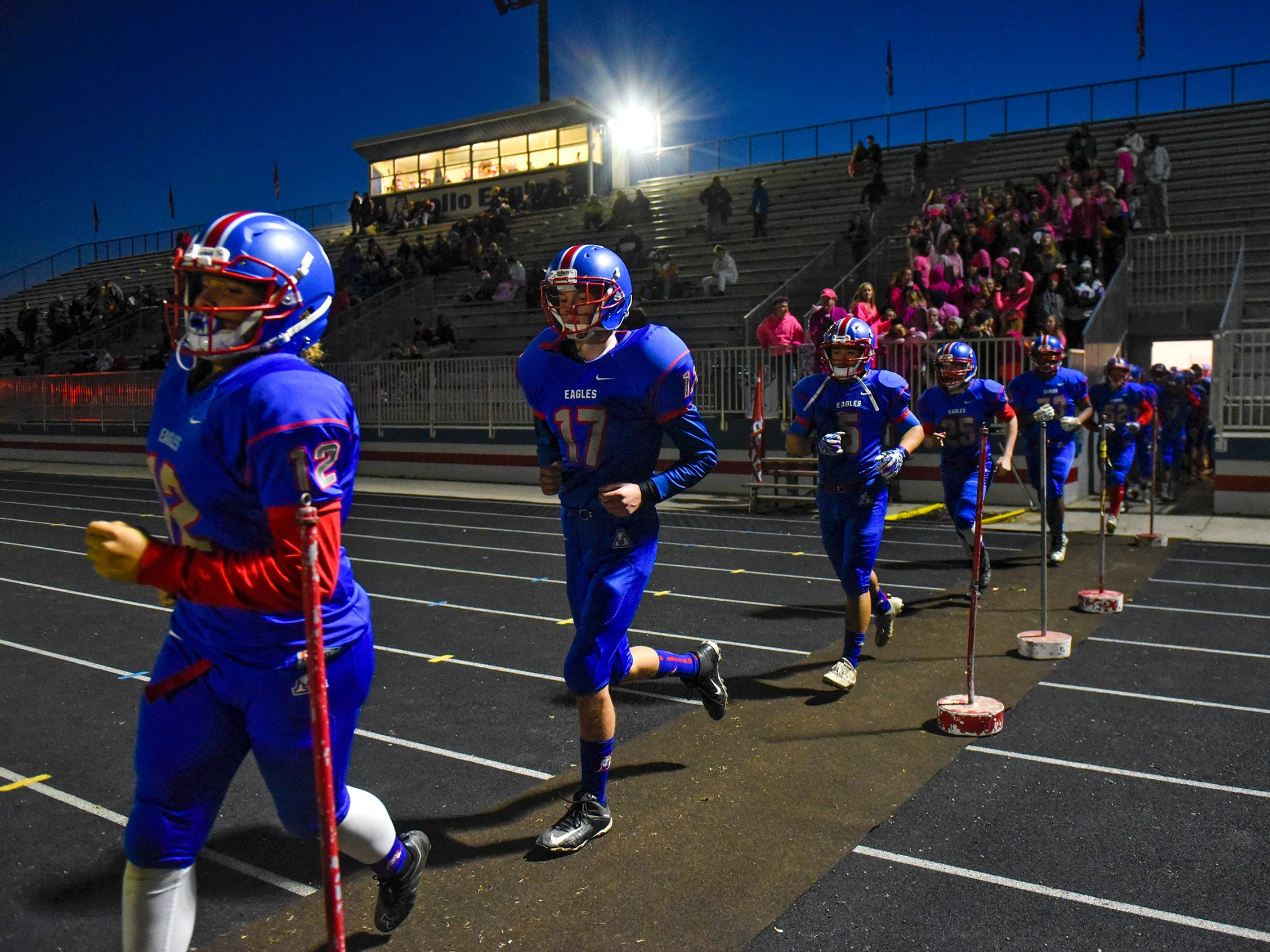Apollo players take the field before the start of the Tuesday, Oct. 23, game against Little Falls in St. Cloud.