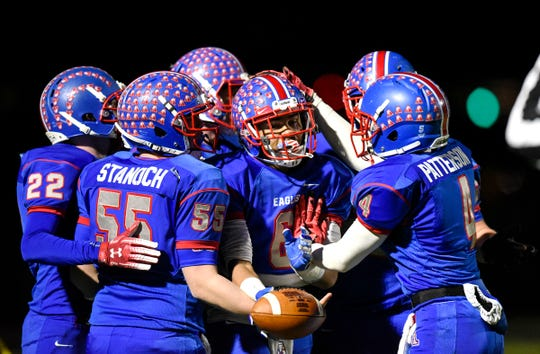 Apollo players celebrate a first-half touchdown during the Tuesday, Oct. 23, game against Little Falls in St. Cloud.