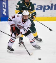 Jack Ahcan skates with the puck during the Saturday, Oct. 20, game against Northern Michigan at the Herb Brooks National Hockey Center in St. Cloud.