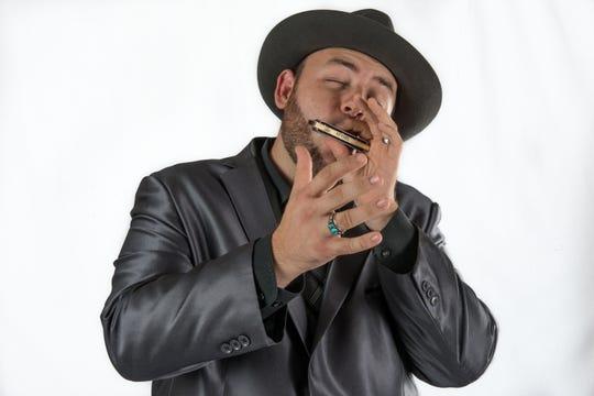 Brandon Santini willfire up his harp Saturday at the Bradfordville Blues Club.