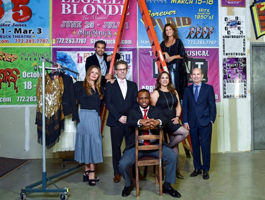 Treasure Coast Fashion Night is Nov. 16 at Flagler Place in Stuart. Pictures are, from left, in chair, Msebenzi Masondo, Engel & Völkers; second row: fashion designer Joanne Snodgrass; sponsor Dr. Avron Lipshitz, Athena Plastic Surgery; Rosa Ceballos of Dr. Michael Sohl's Implant and Cosmetic Dentistry and Dr. Michael Sohl. On ladder: Peter Jones and Jennifer Jones of Starstruck Theatre, the benefiting nonprofit.