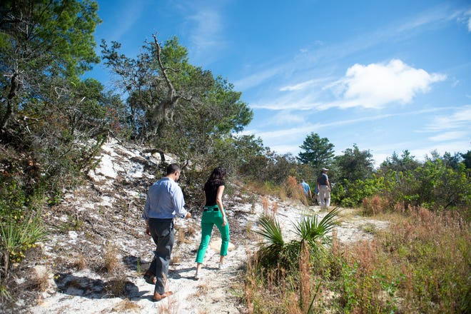 Dignitaries and local residents at the official dedication of the 27-acre Hobe Sound Scrub Preserve in 2018 in Hobe Sound. The elevated scrubland features a loop trail, benches, a pavilion and a parking lot. The ribbon-cutting was on March 30, 2021.