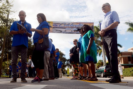 Community members and city officials gathered Wednesday, Oct. 24, 2018 for the unveiling of the centennial celebration banner in downtown Vero Beach to kick off the centennial celebration for the city. The banner, created by Image360 Vero Beach, will hang across 14th Avenue by the Heritage Center through October 2019.