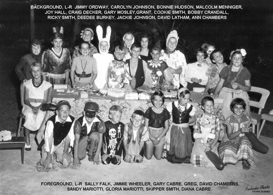 Kids attending a Halloween party in 1954 at the Luckhardt residence.