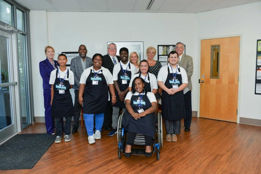 Kerry Padrick, back row, left, Mario Aleus, Doug Baber, Martha Taylor,  Sue McNichol and St. Lucie County Public Schools Superintendent Wayne Gent with students of Student Perks team, Zackery Kussubagyo, Alayjah Simmons, Elijah Metellus, Regina Benitez, Ben Marangio and Megan McClain, in front.
