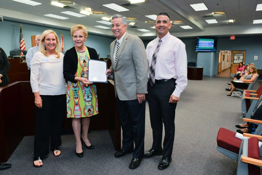 St. Lucie County Public School District  Exceptional Student Education Job Coach Martha Taylor, left, Commissioner Frannie Hutchinson, Schools Superintendent  Wayne Gent, and Port St. Lucie High School Principal Adrian O'Campo.