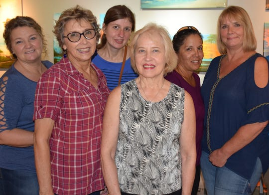 Women's Refuge resident Missy, left, Biblical Counselor Carol McDaniel, and residents Melissa, Lori, Carol and Kimberly at the Florida Highwaymen Landscape Art Gallery in downtown Vero Beach during the October First Friday Gallery Stroll.
