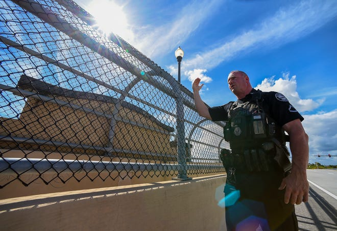 """""""It was a pretty scary event for all of us,"""" said Florida Highway Patrol trooper William Shogran Wednesday, Oct. 24, 2018, while describing how he talked a teenage girl out of committing suicide by jumping off of the Florida Turnpike overpass on Becker Road in Port St. Lucie. """"We were just glad we were able to get her down. She's only 14-years-old. She has her whole life ahead of her."""""""