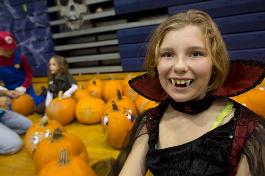 "Ten-year-old Heaven Wilson likes her Countess Dracula costume, especially her new ""fangs."""